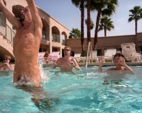 PALM SPRINGS, UNITED STATES - MARCH 2001: Guests at the Desert Shadows Inn Resort for nudists play a game of water volleyball.